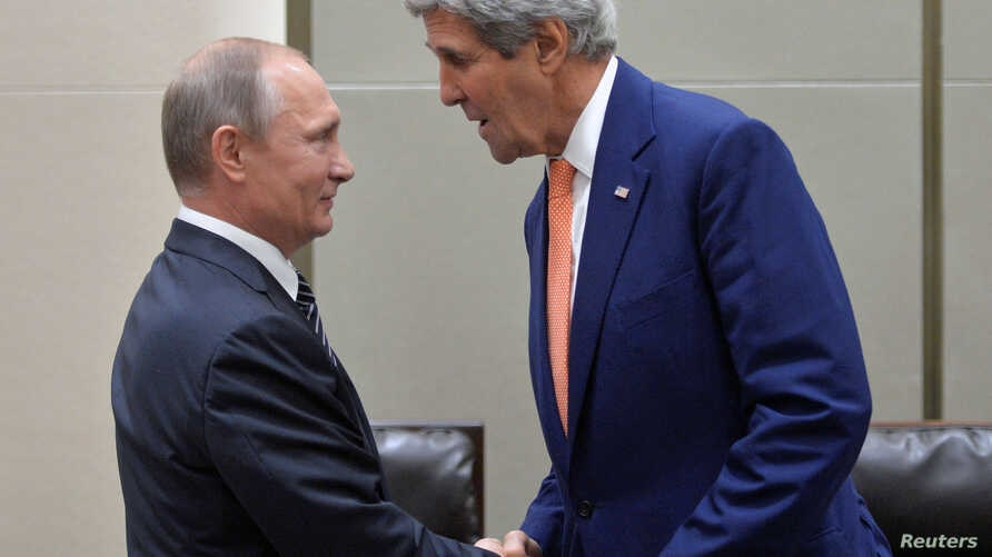 Russian President Vladimir Putin (L) greets U.S. Secretary of State John Kerry ahead of a meeting with U.S. President Barack Obama (not seen) on the sidelines of the G-20 Summit in Hangzhou, China, Sept. 5, 2016.
