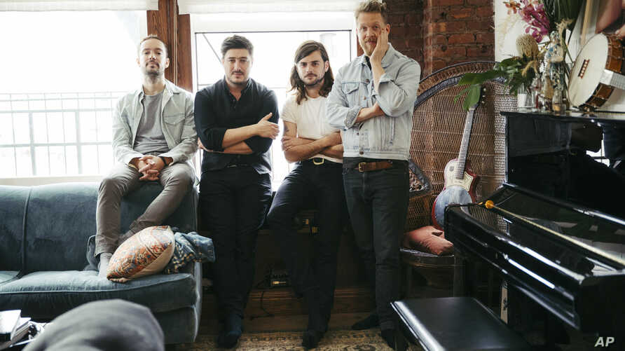 "FILE - Members of Mumford & Sons, from left, Ben Lovett, Marcus Mumford, Winston Marshall and Ted Dwane pose for a portrait in New York to promote their fourth album ""Delta,"" Sept. 28, 2018."
