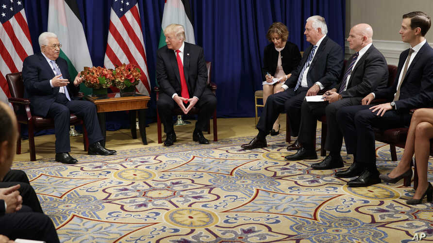 President Donald Trump meets with Palestinian President Mahmoud Abbas at the Palace Hotel during the United Nations General Assembly, in New York, Sept. 20, 2017. From left, Abbas, Trump, an unidentified interpreter, Secretary of State Rex Tillerson,