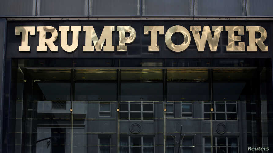 FILE- The Trump Tower logo in New York, May 23, 2016.