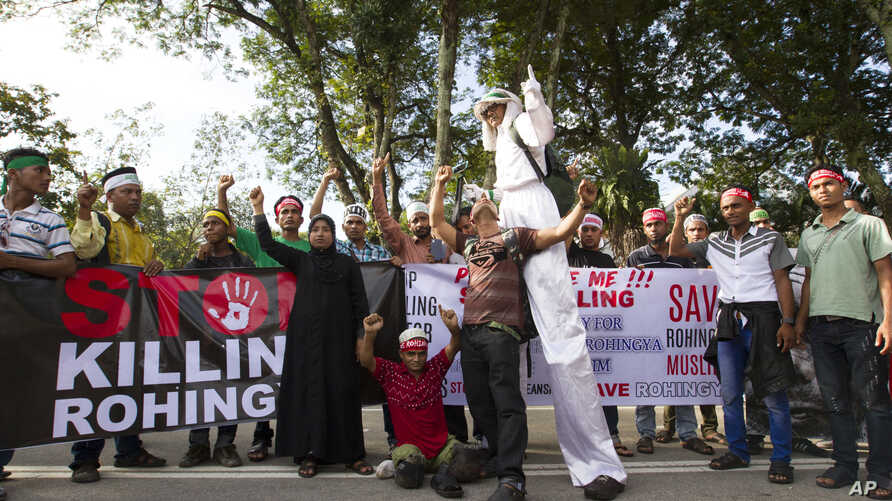 Myanmar ethnic Rohingya Muslims shout slogans during a protest against the persecution of Rohingya Muslims in Myanmar, in Kuala Lumpur, Malaysia, Sunday, Dec. 4, 2016.