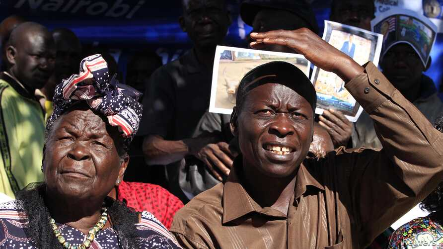 Sarah Hussein Obama (L), grandmother to President Obama and his uncle Said Obama attend a news conference to celebrates his re-election in his ancestral home village of Nyangoma Kogelo, Kenya, November 7, 2012.