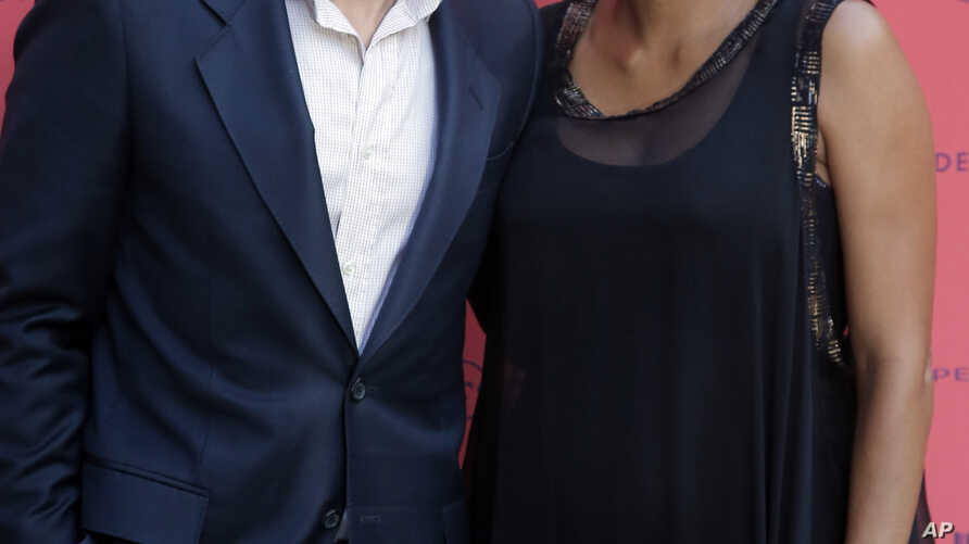 Actor and president of the Champs-Elysees Film Festival Olivier Martinez, left, poses with Actress Halle Berry, June 13, 2013.