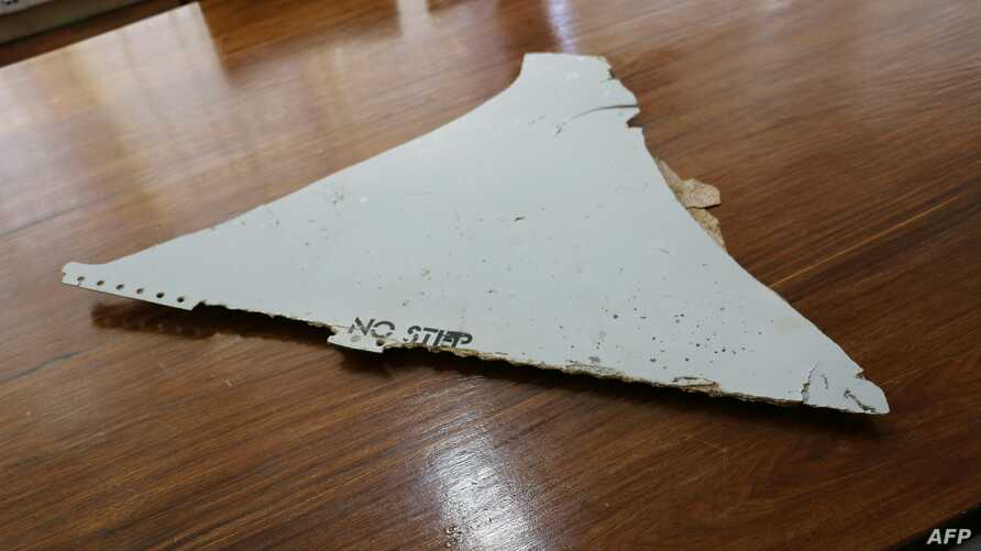 This file photo taken on March 3, 2016 shows a piece of suspected aircraft wreckage found off the east African coast of Mozambique at Mozambique's Civil Aviation Institute (IACM) in Maputo.