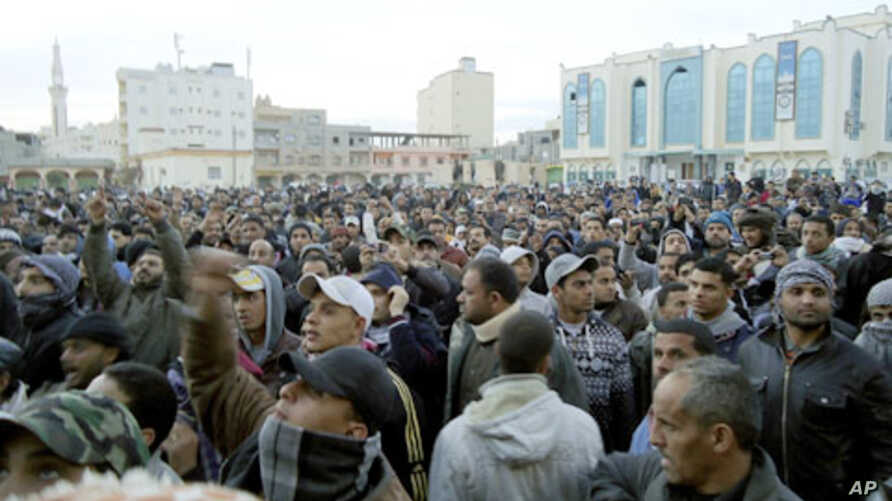 Libyan protesters take part in a demonstration in the seaport city of Tobruk, February 20, 2011