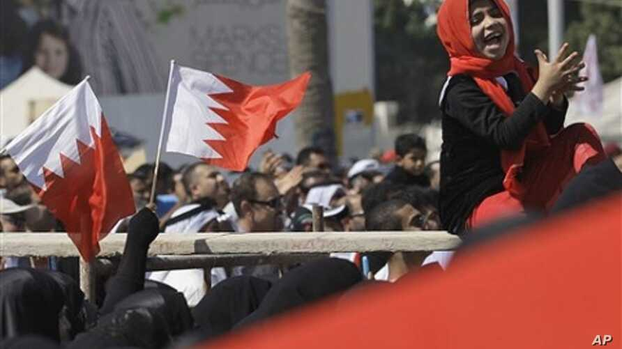 Bahraini anti-government protesters chant and wave Bahraini flags at the Pearl roundabout in Manama, Bahrain, Sunday, Feb. 20, 2011