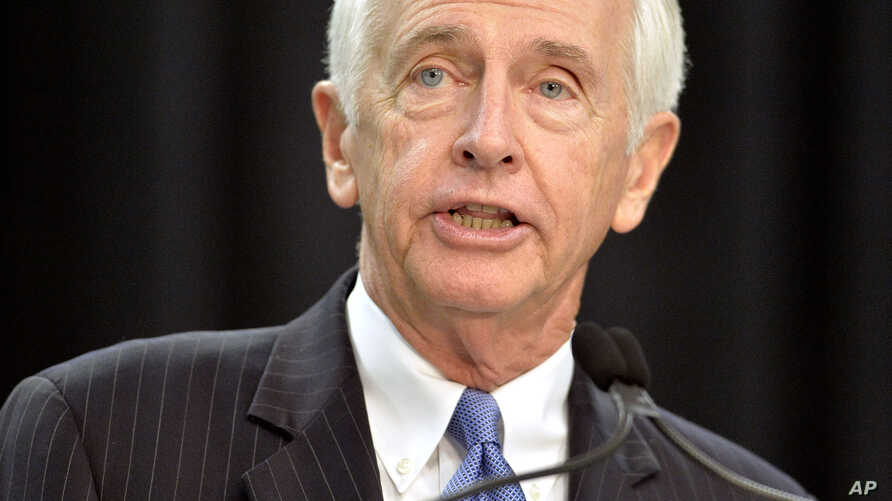 FILE - Kentucky Governor Steve Beshear speaks to the media and a group of Ford employees at the Kentucky Truck Plant in Louisville, Dec. 1, 2015.