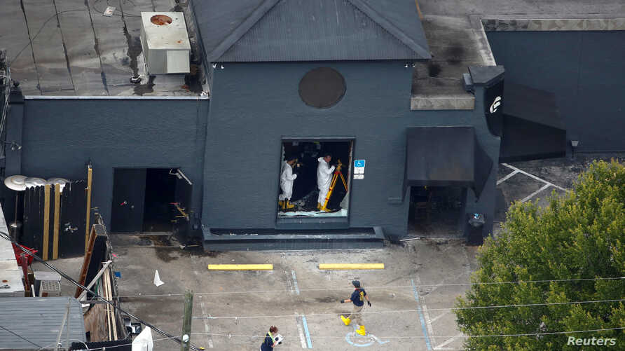 Federal Bureau of Investigation (FBI) officials collect evidence from the Pulse gay night club, the site of a mass shooting days earlier, in Orlando, Florida, U.S., June 15, 2016.