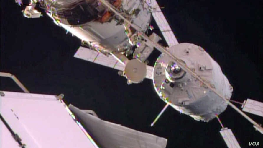 The Automated Transfer Vehicle holds for checks just a few feet away from docking to the Zvezda service module.