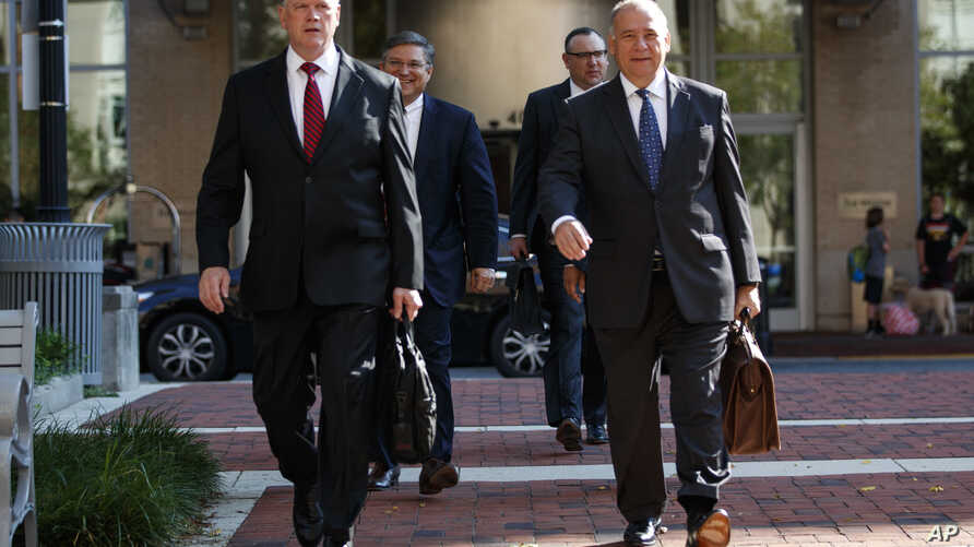 The defense team for Paul Manafort, including, Kevin Downing (L), and Thomas Zehnle (R) arrive at the Albert V. Bryan United States Courthouse for the trial of former Trump campaign chairman, Aug. 10, 2018, in Alexandria, Va.