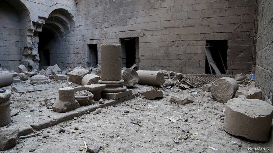 "Damaged pillars lie on the ground in Sahat al-Mumathileen (Arabic for the ""Yard of Actors""), a square in the western part of Bosra's ancient citadel, after what activists said was an airstrike by forces loyal to Syria's president Bashar al-Assad in t"