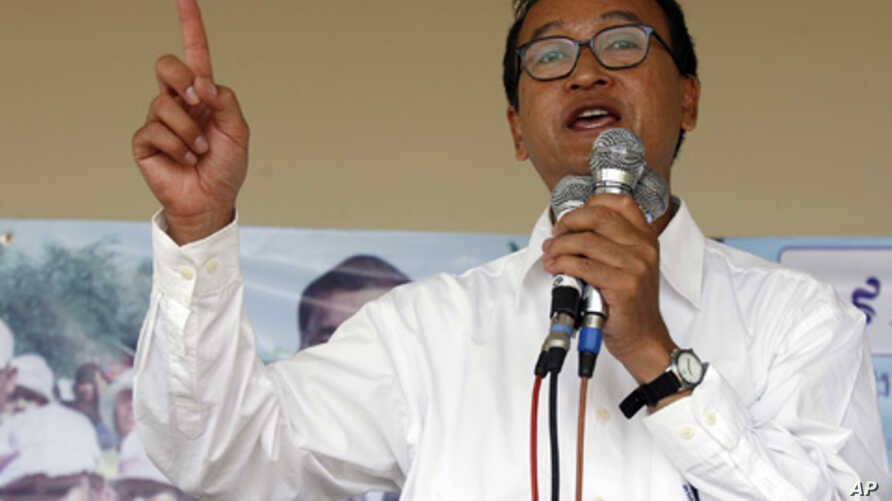 Sam Rainsy, leader of Cambodia's opposition Sam Rainsy Party, speaks during a campaign rally in Kandal province, Cambodia, July 11, 2008
