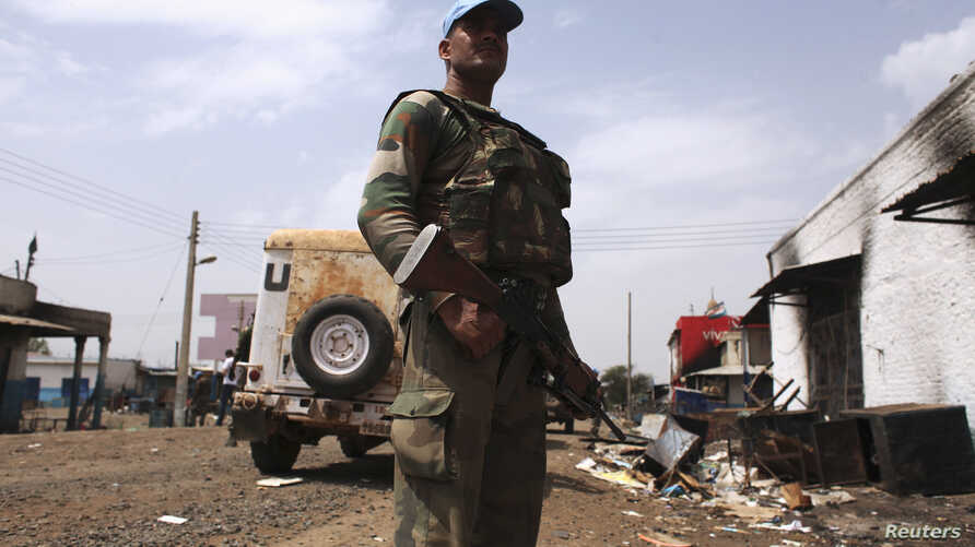 FILE -A United Nations peacekeeper holds position during a patrol in the town of Malakal, Upper Nile State.