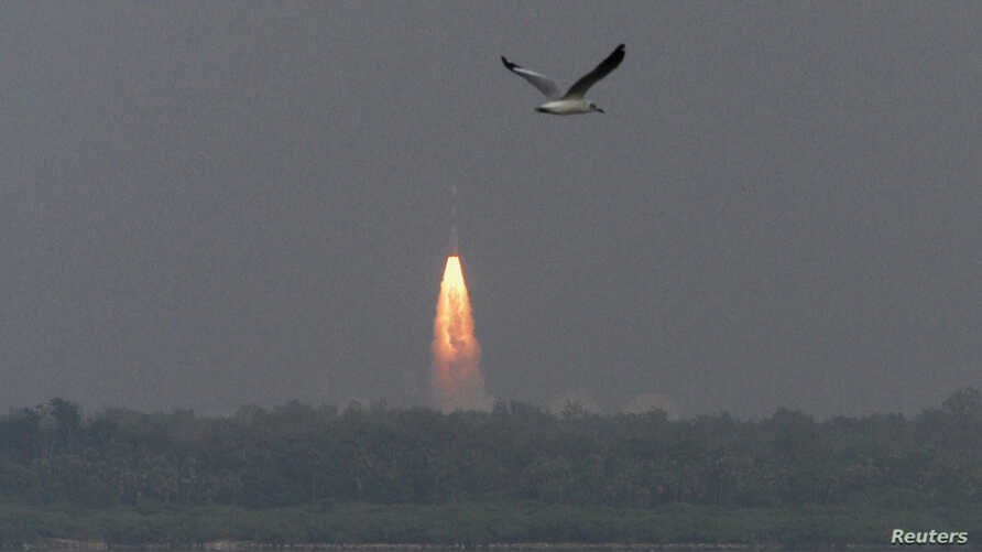India's Polar Satellite Launch Vehicle (PSLV-C25), carrying the Mars orbiter, lifts off from the Satish Dhawan Space Centre in Sriharikota, about 100 km (62 miles) north of the southern Indian city of Chennai, Nov. 5, 2013.