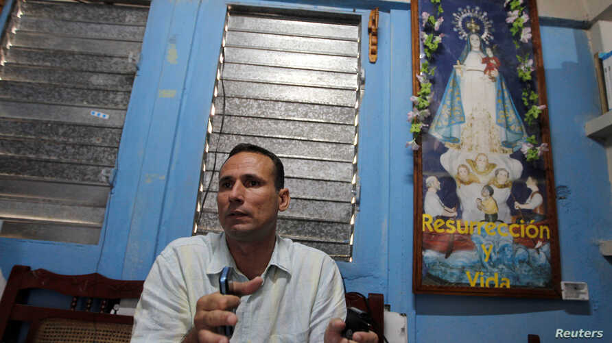 FILE - Cuban dissident Jose Daniel Ferrer gives an interview to Reuters inside his home in Palmarito de Cauto, March 25, 2012.