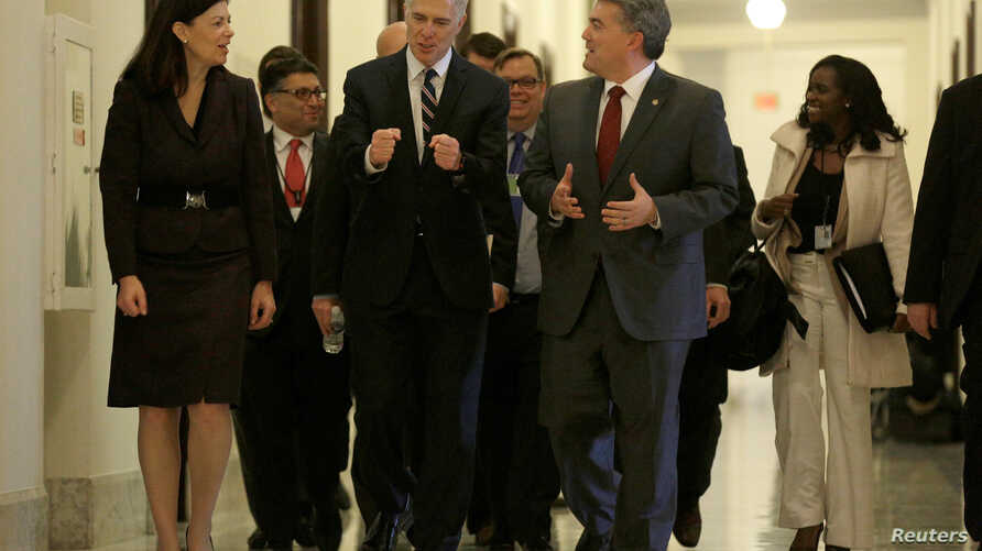 Supreme Court Nominee Judge Neil Gorsuch (C) walks with former Senator Kelly Ayotte and Senator Cory Gardner (R-CO) before a meeting on Capitol Hill in Washington, Feb. 1, 2017.