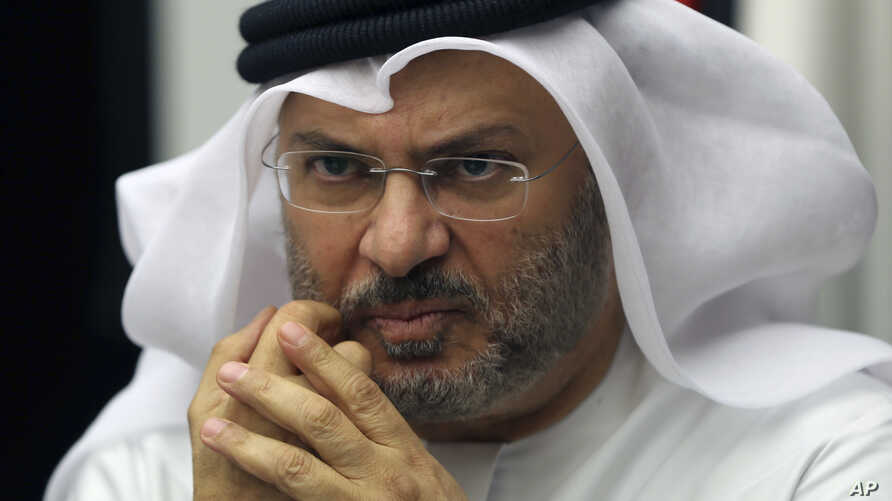 FILE - Anwar Gargash, UAE foreign minister, is pictured talking to reporters in Dubai, June 24, 2017.