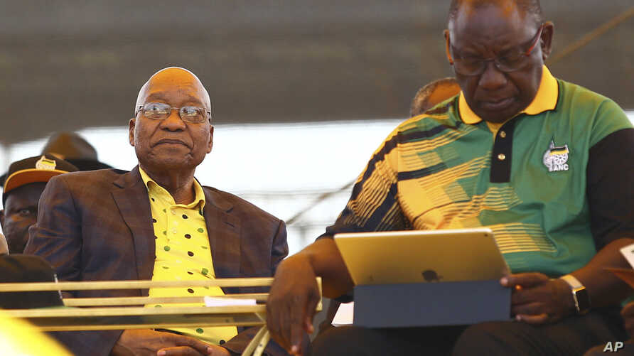 Newly-elected ruling African National Congress (ANC) party president, Cyril Ramaphosa, right, and former ANC president and South African President Jacob Zuma, left, attend the party's 106th birthday celebrations in East London, South Africa, Jan. 13,...