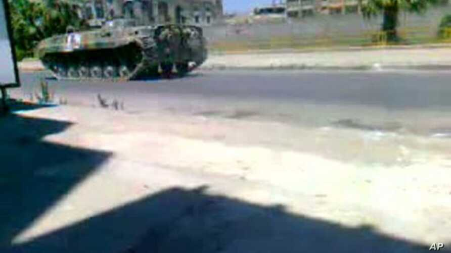 Image taken from video footage uploaded on YouTube shows a Syrian army tank deployed in a main street in the Khalidiya area of the protest hub of Homs, 160 kilometers north of Damascus, on August 17, 2011.