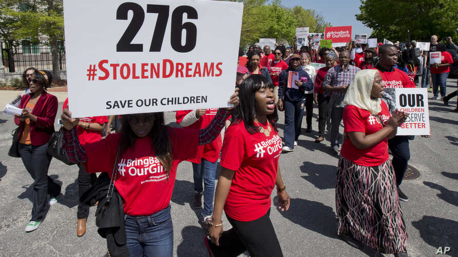 Protestors march in front of the Nigerian embassy in northwest Washington, Tuesday, May 6, 2014, protesting the kidnapping of nearly 300 teenage schoolgirls, abducted from a school in the remote northeast of Nigeria three weeks ago.