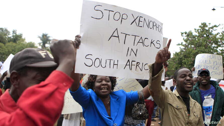 Zimbabweans rally against recent anti-immigrant violence in South Africa, outside the South African embassy in Harare, April 17, 2015.