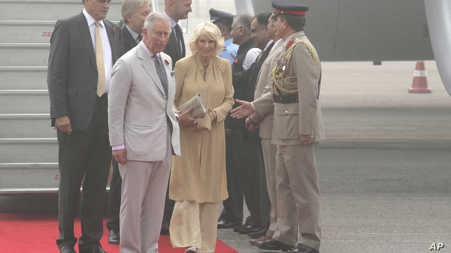 Britain's Prince Charles and his wife Camilla, Duchess of Cornwall, arrive in New Delhi, India, Wednesday, Nov. 8, 2017. The royal couple are in the country on a two-day visit.