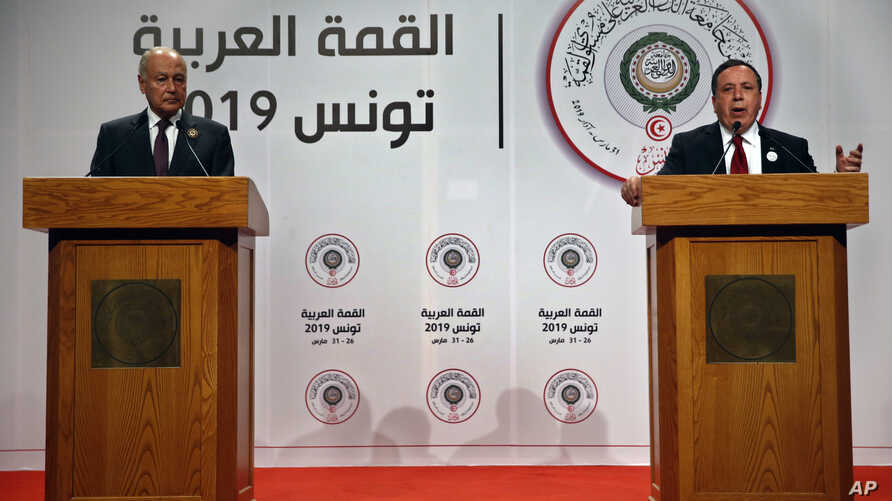 Tunisian Foreign Minister Khemaies Jhinaoui, right, speaks during a joint press conference with Arab League Secretary-General, Ahmed Aboul Gheit, at the end of the Arab Summit, in Tunis, Tunisia, Sunday, March 31, 2019.