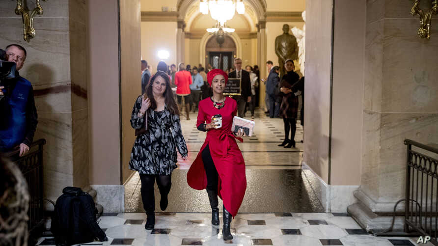 Rep. Ilhan Omar, Democrat-Minnesota, center, walks through the halls of the Capitol Building in Washington, Jan. 16, 2019.