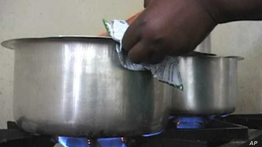 Saving money is one of the many benefits of clean cookstoves, which use natural gas, solar power or electricity, Kenya, May 2, 2012.