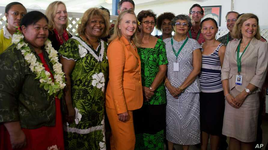"""U.S. Secretary of State Hillary Rodham Clinton, center, poses with female participants of the """"Dialogue on Gender Equality"""" in Rarotonga, Cook Islands,Aug. 31, 2012."""