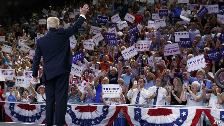 Republican presidential candidate Donald Trump waves to the crowd as he arrives at a campaign rally at the University of North Carolina Wilmington, in Wilmington, N.C., Aug. 9, 2016.