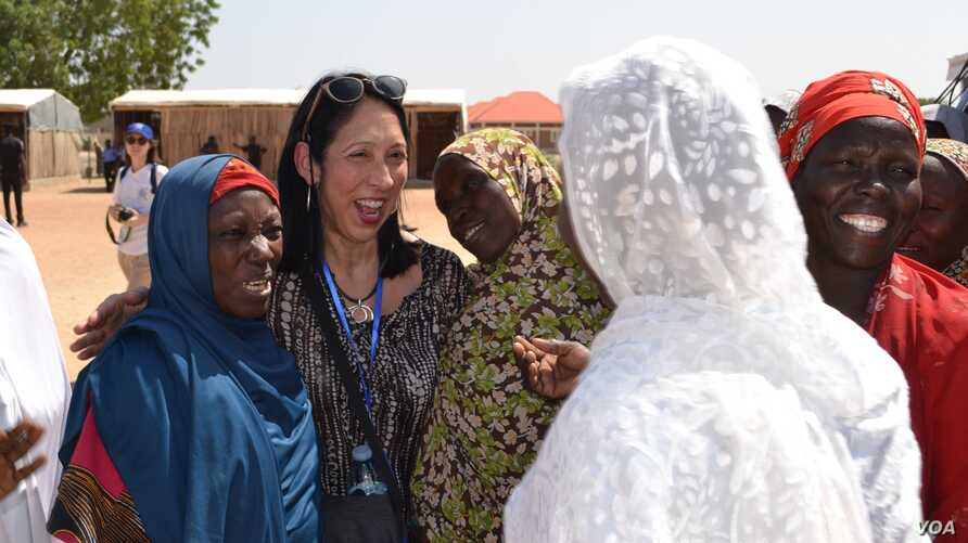 U.S. Deputy Ambassador to the United Nations Michelle Sison meets with women at an IDP camp in Maiduguri, NE Nigeria.