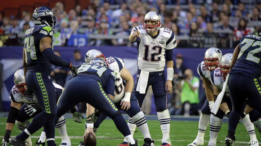 New England Patriots quarterback Tom Brady (12) calls a play against the Seattle Seahawks during the first half of NFL Super Bowl XLIX football game Feb. 1, 2015, in Glendale, Arizona.
