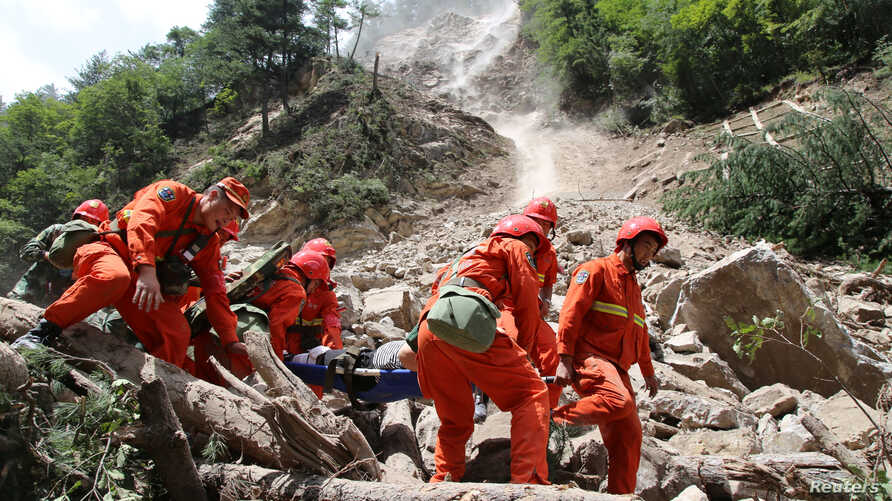 Rescue workers carry a survivor after an earthquake in Jiuzhaigou county, Ngawa prefecture, Sichuan province, China, Aug. 9, 2017.