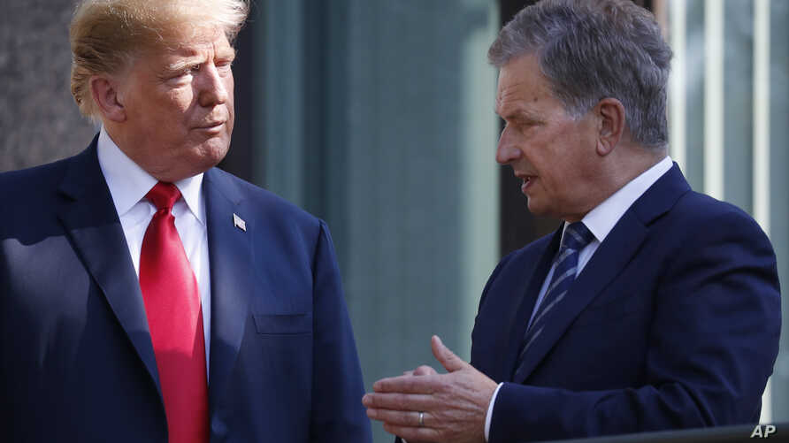 FILE - In this July 16, 2018 photo, U.S. President Donald Trump, left, talks with Finnish President Sauli Niinisto as they pose for a photo in Helsinki, Finland.