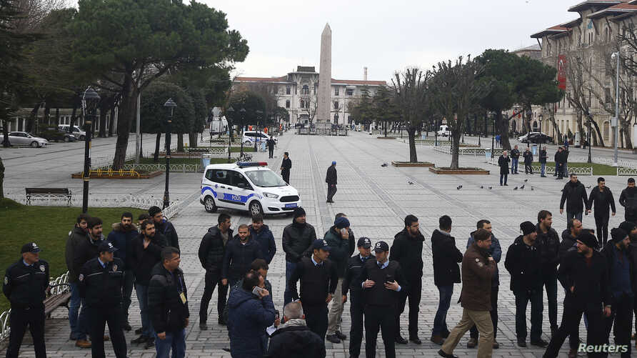FILE - Security services secure the area around the Obelisk of Theodosius at Sultanahmet Square in Istanbul, Turkey, Jan. 13, 2016. Turkish authorities detained three Russian nationals suspected of links with Islamic State following a suicide bomb at