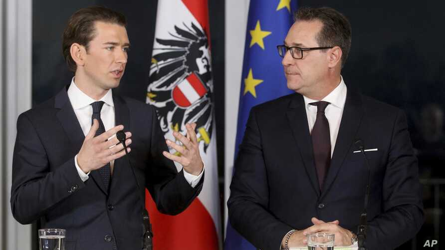 Leader of the Austrian People's Party, OVP, Sebastian Kurz and Heinz-Christian Strache, chairman of the right-wing Freedom Party, FPO, from left, talk during a joint news conference after forming a new coalition government in Vienna, Austria, Dec. 16...