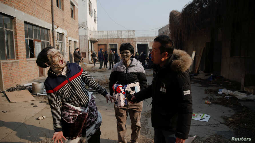 Actors rehearse their roles during the filming of the post-apocalyptic movie at an abandoned factory complex in Langfang, Hebei province, China, Dec. 16, 2016. Demand for video streaming of movies and TV shows has opened the door to new films and fil