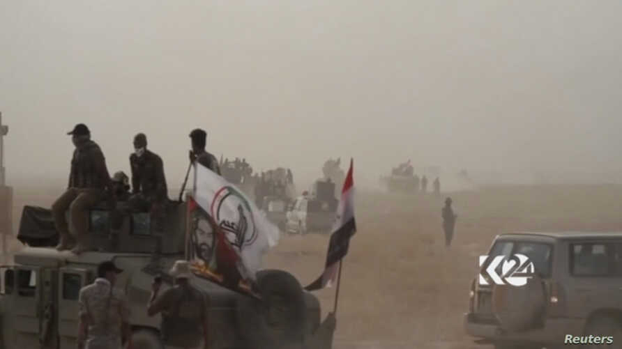 This image made from video provided by Kurdistan 24 shows an Iraqi tank moving into position as forces begun the operation to retake the town of Hawija, Iraq from the Islamic State group, Sept. 21, 2017.