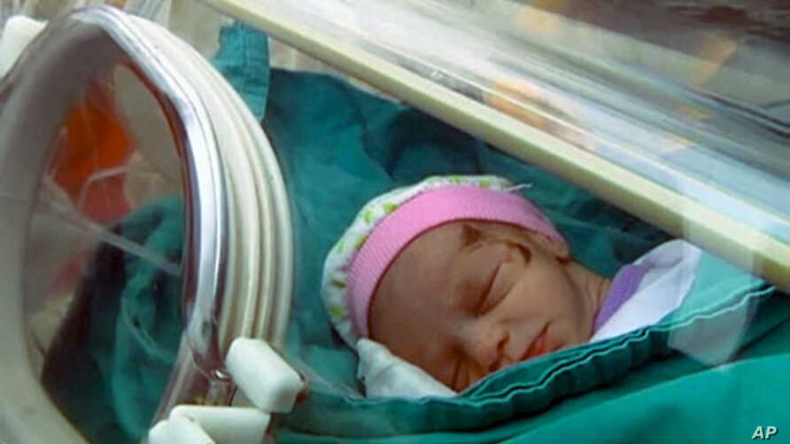 A baby girl, rescued from a building that collapsed during an earthquake, is carried in an incubator in a hospital in Ercis, near the eastern Turkish city of Van, in this still image taken from video footage October 25, 2011