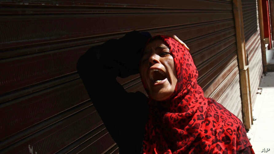 An Egyptian woman mourns after a judge sentenced to death 683 alleged supporters of the country's ousted Islamist president over acts of violence and the murder of policemen in the latest mass trial in the southern city of Minya, Egypt, April 28, 201