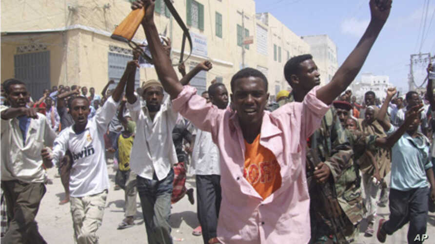 Somali protesters march  in Mogadishu, Somalia where protesters took to the streets in support of current Prime Minister Mohamed Abdullahi Farmajo. A new accord extending the government's term by a year requires Prime Minister Mohamed Abdullahi Moham
