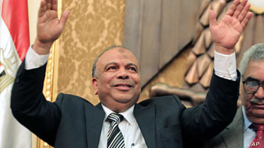 Newly elected speaker of the Egyptian parliament, Saad el-Katatni of the Muslim Brotherhood, salutes during the first session of the newly-elected assembly in Cairo, January 23, 2012