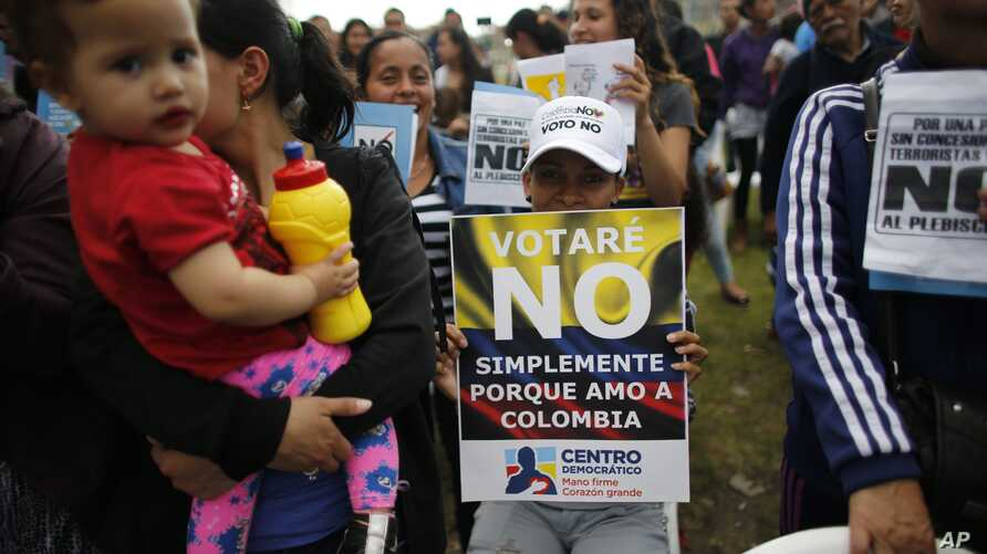 "Opponents to the peace deal signed between the Colombia government and rebels of the Revolutionary Armed Forces of Colombia, FARC, attend an event to promote the ""No"" vote in the upcoming referendum in Bogota, Colombia, Oct 1, 2016."
