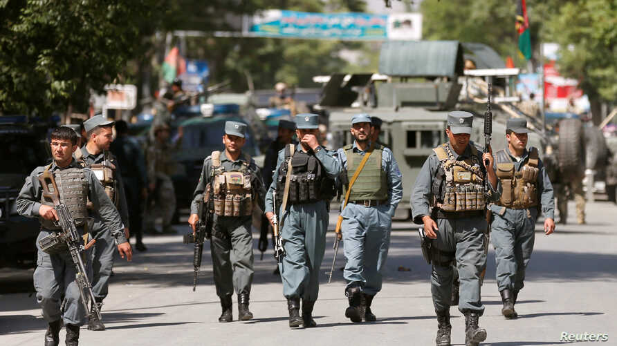 Afghan policemen arrive at the site of an attack and gun fire in Kabul, May 9, 2018.