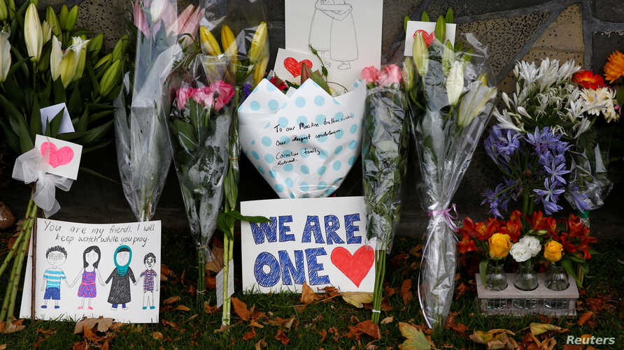 Flowers and signs are seen at a memorial as tributes to victims of the mosque attacks near Linwood mosque in Christchurch, New Zealand, March 16, 2019.