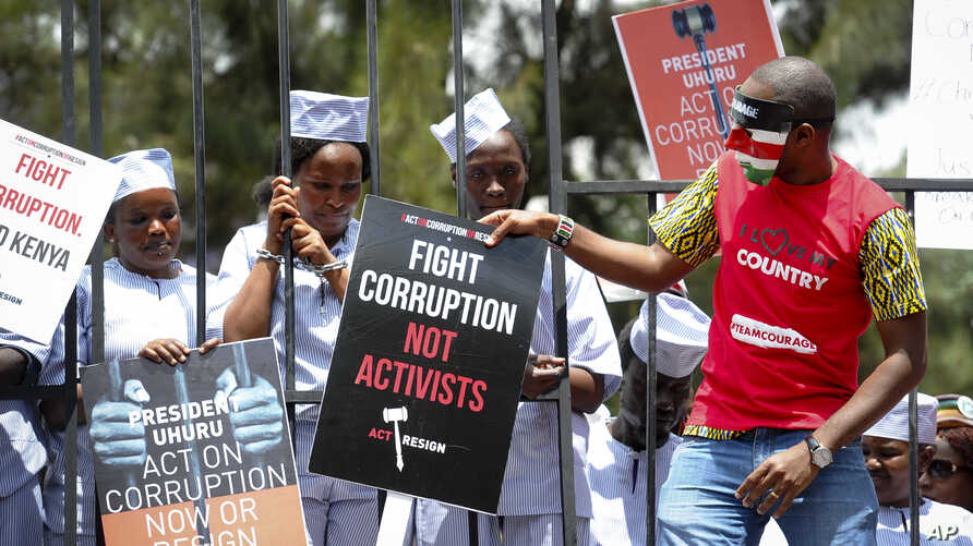 Kenya Corruption: Demonstrators wear mock prison outfits to show that they want to imprison those engaged in corruption, in Nairobi, Kenya Thursday, Nov. 3, 2016.