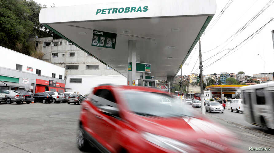 A car departs from a Petrobras gas station in the outskirts of Sao Paulo, Brazil, July 31, 2018.