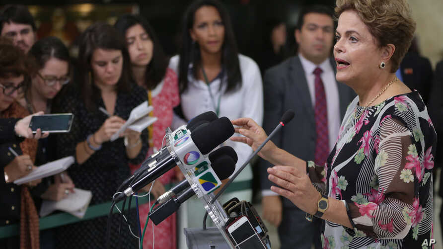Brazil's President Dilma Rousseff speaks about proposed budget cuts during a press conference at the Planalto Presidential Palace, in Brasilia, Sept. 15, 2015.