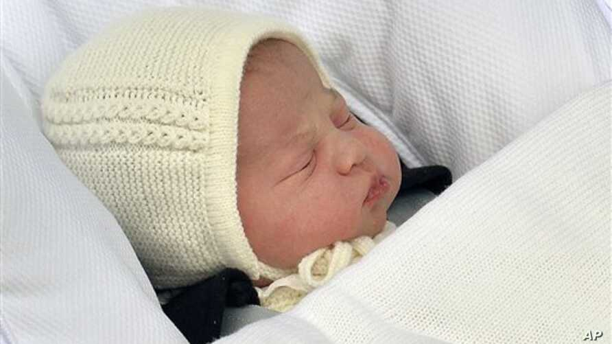 The newborn baby princess, born to parents Kate Duchess of Cambridge and Prince William, is carried in a car seat by her father from The Lindo Wing of St. Mary's Hospital, in London, Saturday, May 2, 2015.  Kate, the Duchess of Cambridge, gave birth